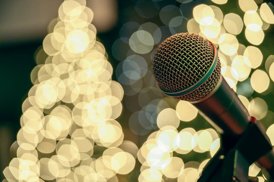 Bokeh photography of microphone with lights