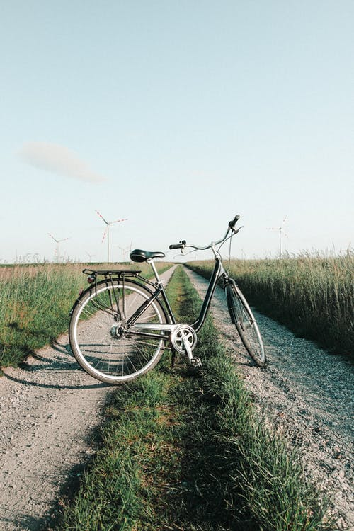 Photo Of Bicycle On The Middle Of Dirt Road