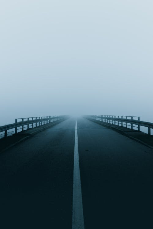 Empty Road Under Cloudy Sky