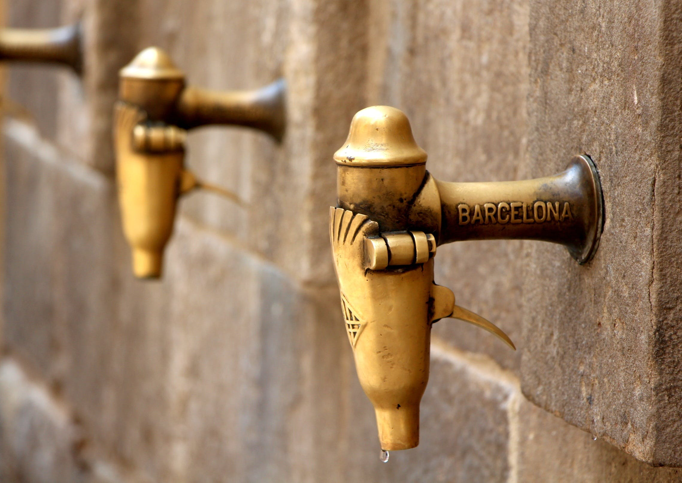 Brown Barcelona Water Faucet Selective Focus Photography