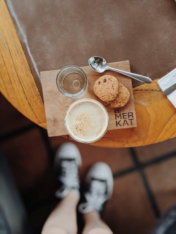 Cup of Beverage Beside Cookie