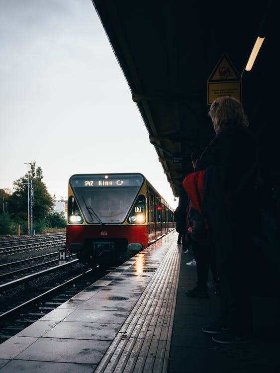 People Standing on Train Station Waiting for Train