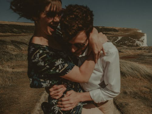 Selective Focus Photography of Woman Hugging Man