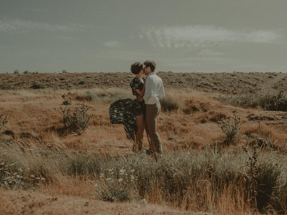 Standing Woman and Man Kissing