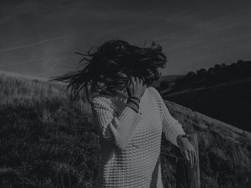 Grayscale Photography of Woman Flipping Hair