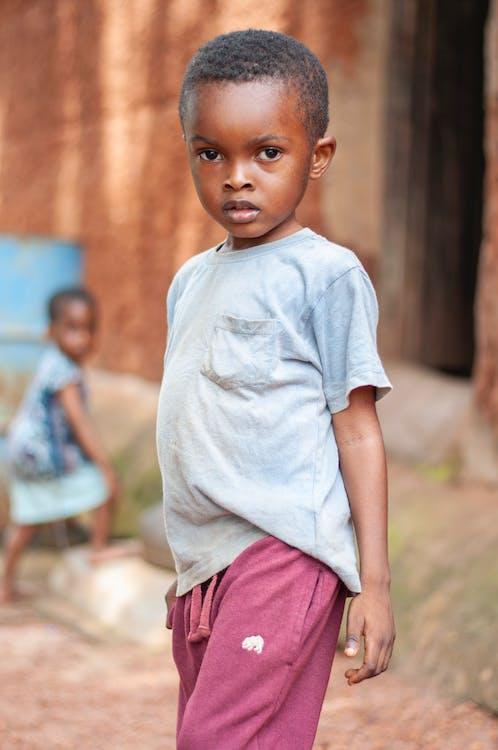 Little Boy Wearing Blue Shirt