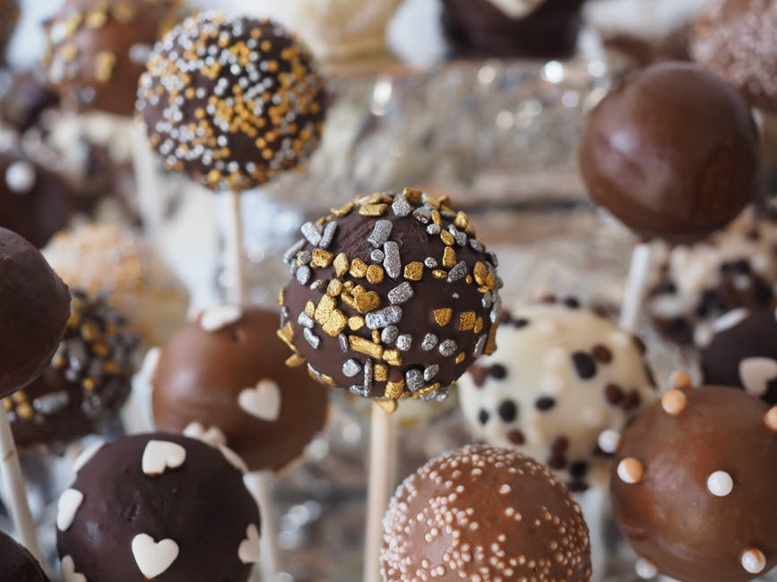 Round Chocolate Coated Pastry on White Stick