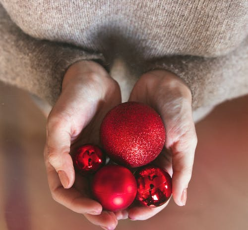 Four Red Baubles on Hand