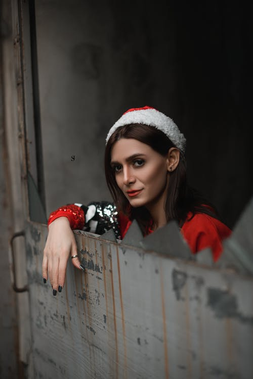 Woman Wearing Red Santa Hat