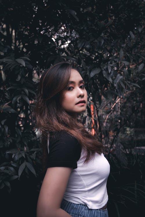 Woman Wearing Black and White Shirt Standing Near Tree