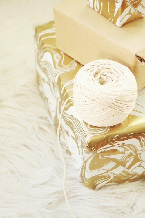 White Yarn Thread Near Brown Box