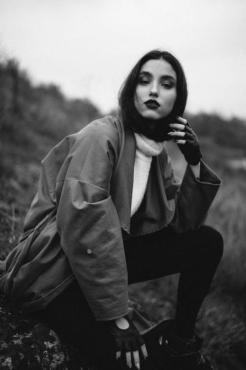 Greyscale Photo of Woman Wearing Coat