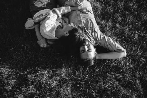 Couple Lying Down the Field