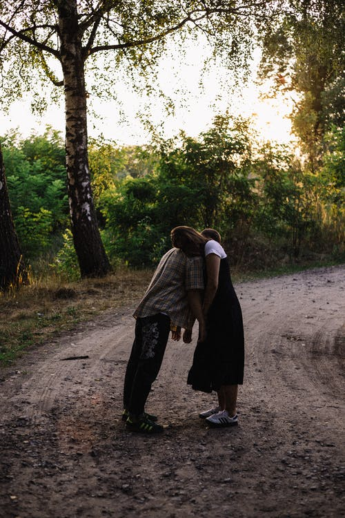 Couple Hugging While Standing on Dirtway