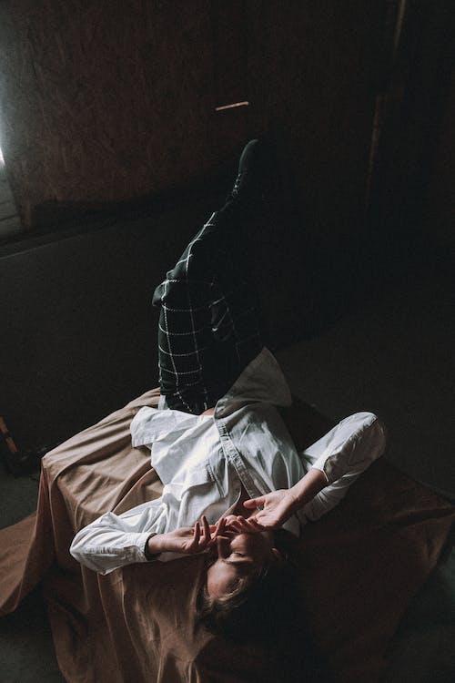 Woman Wearing Dress Shirt Lying on Bed