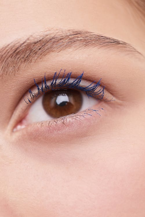 Woman Left Eye With Blue Eyelashes