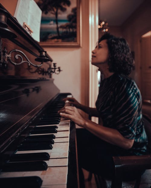 Woman Playing Piano Photograph
