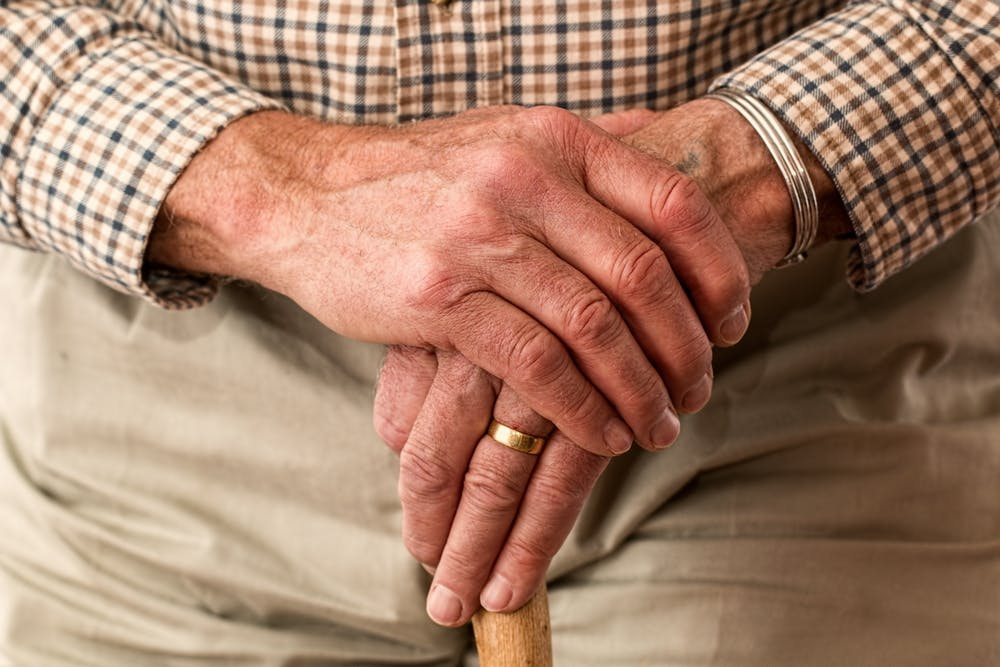 An elderly man holding a rod. | Photo: Pexels