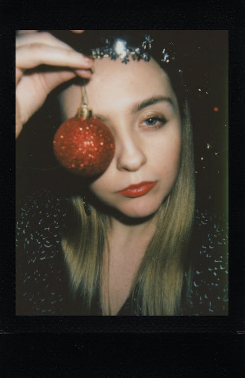 Portrait Photo of Woman Holding Christmas Ball