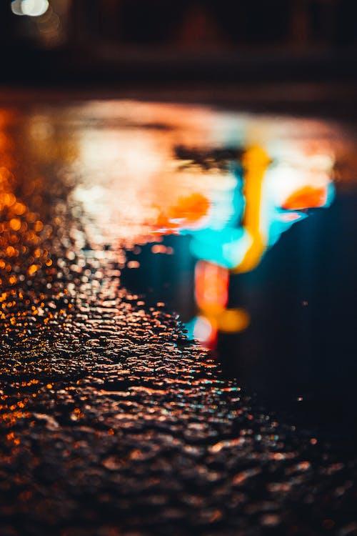 Water Droplets on Black Asphalt Road during Night Time
