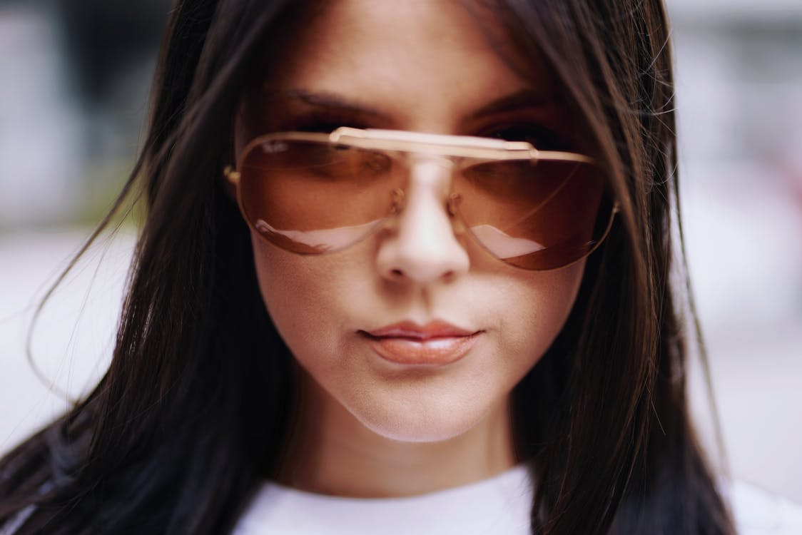 Woman Wearing White Crew-neck Shirt and Sunglasses