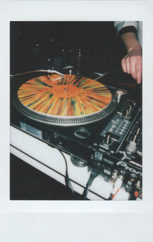 Person Using Black Turntable