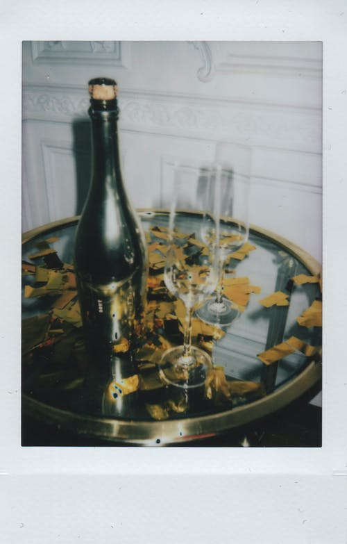 Black and Beige Wine Bottle on Table