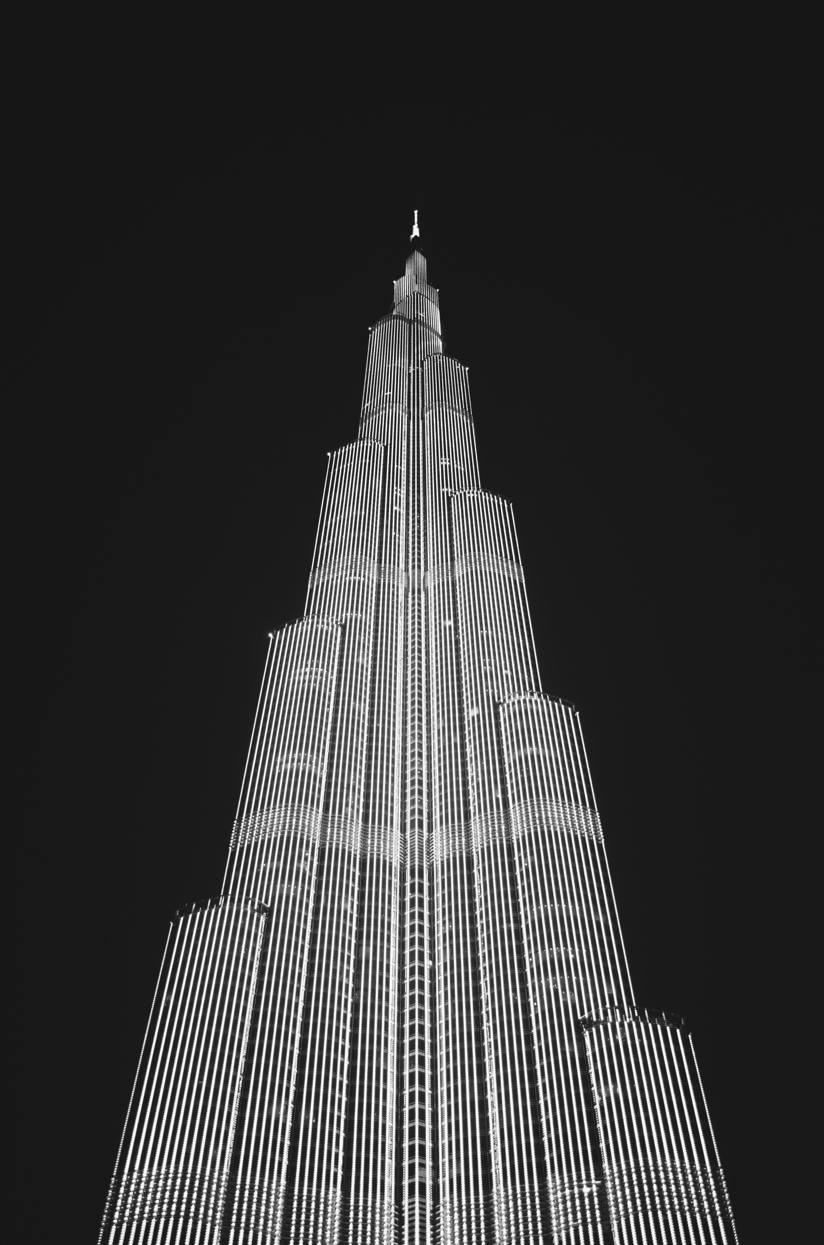 Low Angle View of Skyscraper Against Sky at Night