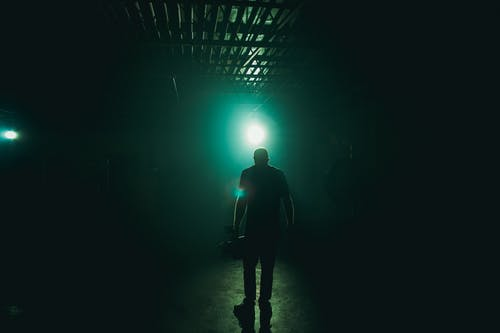 Man Standing With Blue Light