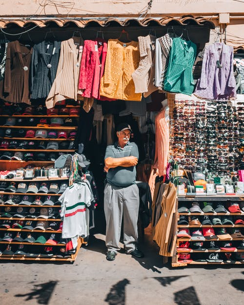 Man Standing in Front of Store