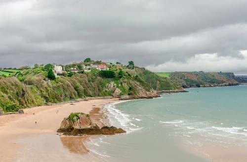 Free stock photo of aqua ocean, beach walkers, cliffs, cliffside town