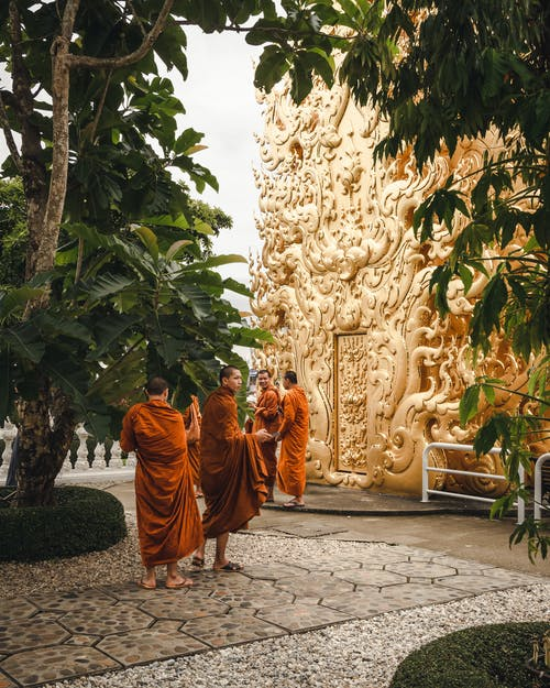 Four Monks Beside Gold Statue