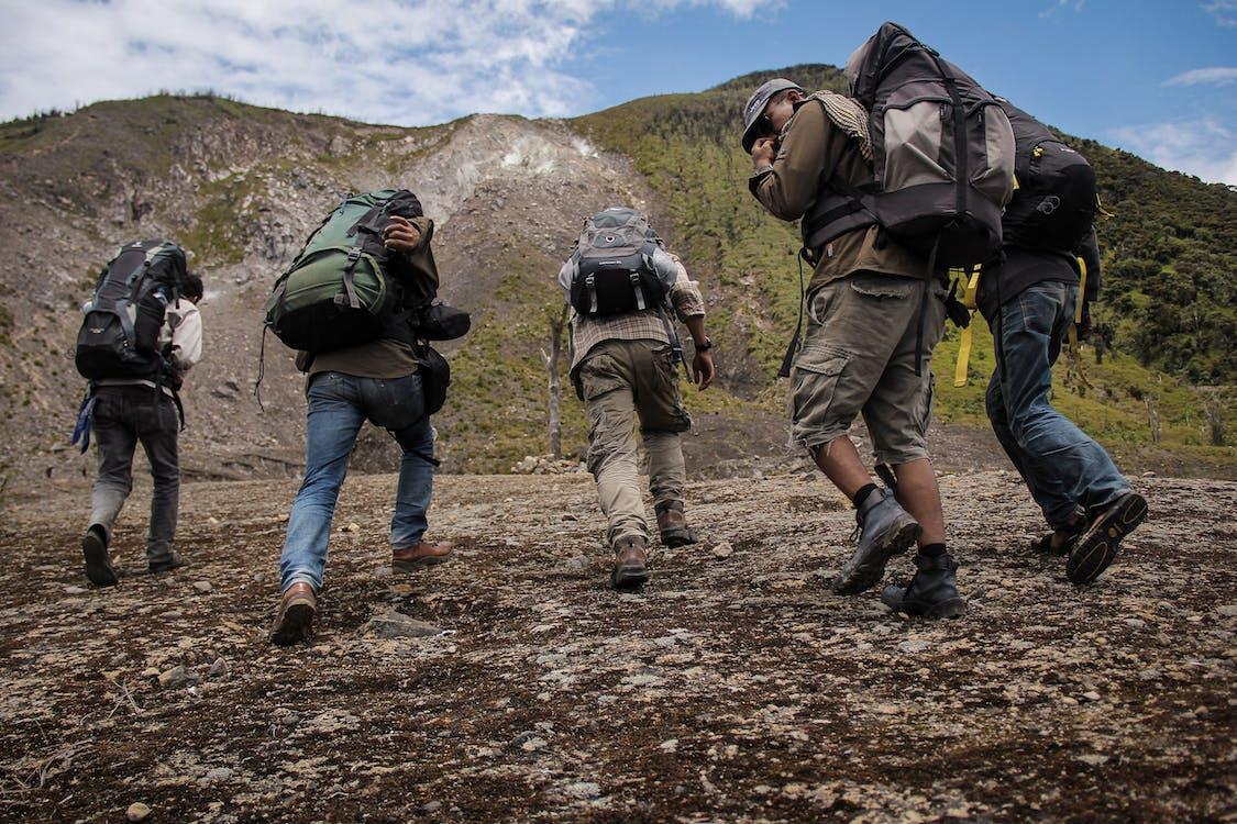 Five Men Running Near Mountain
