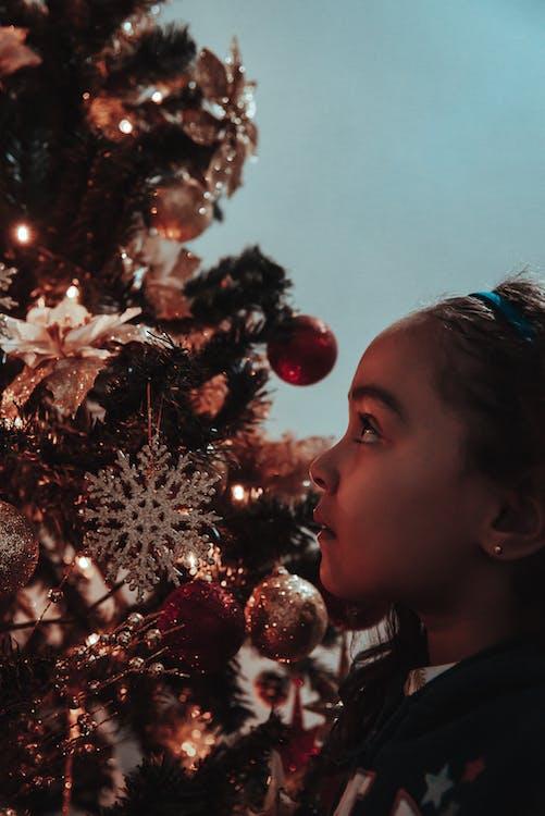 Woman Facing Green Christmas Tree