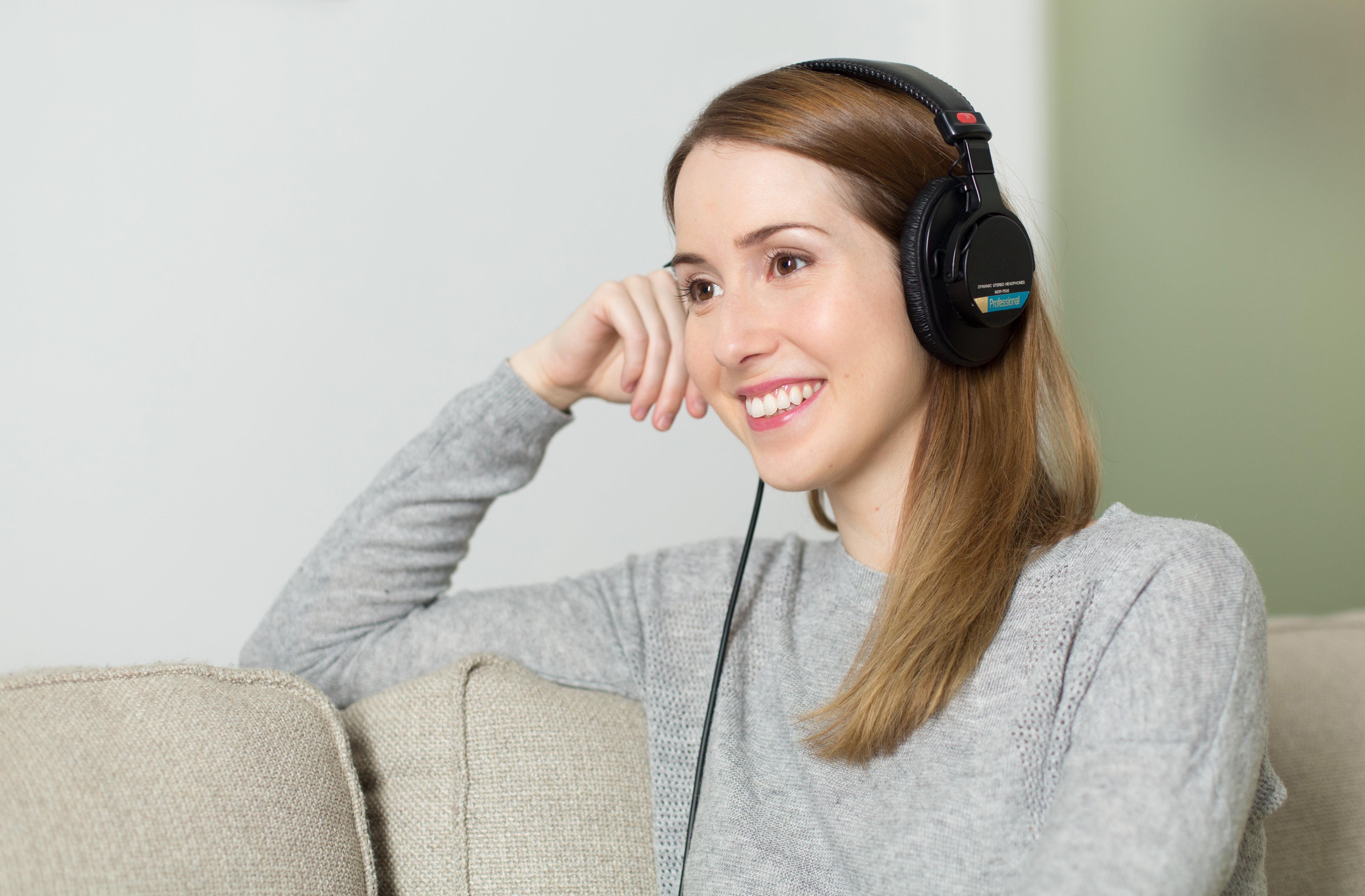 Woman Wearing Black Headphones Smiling