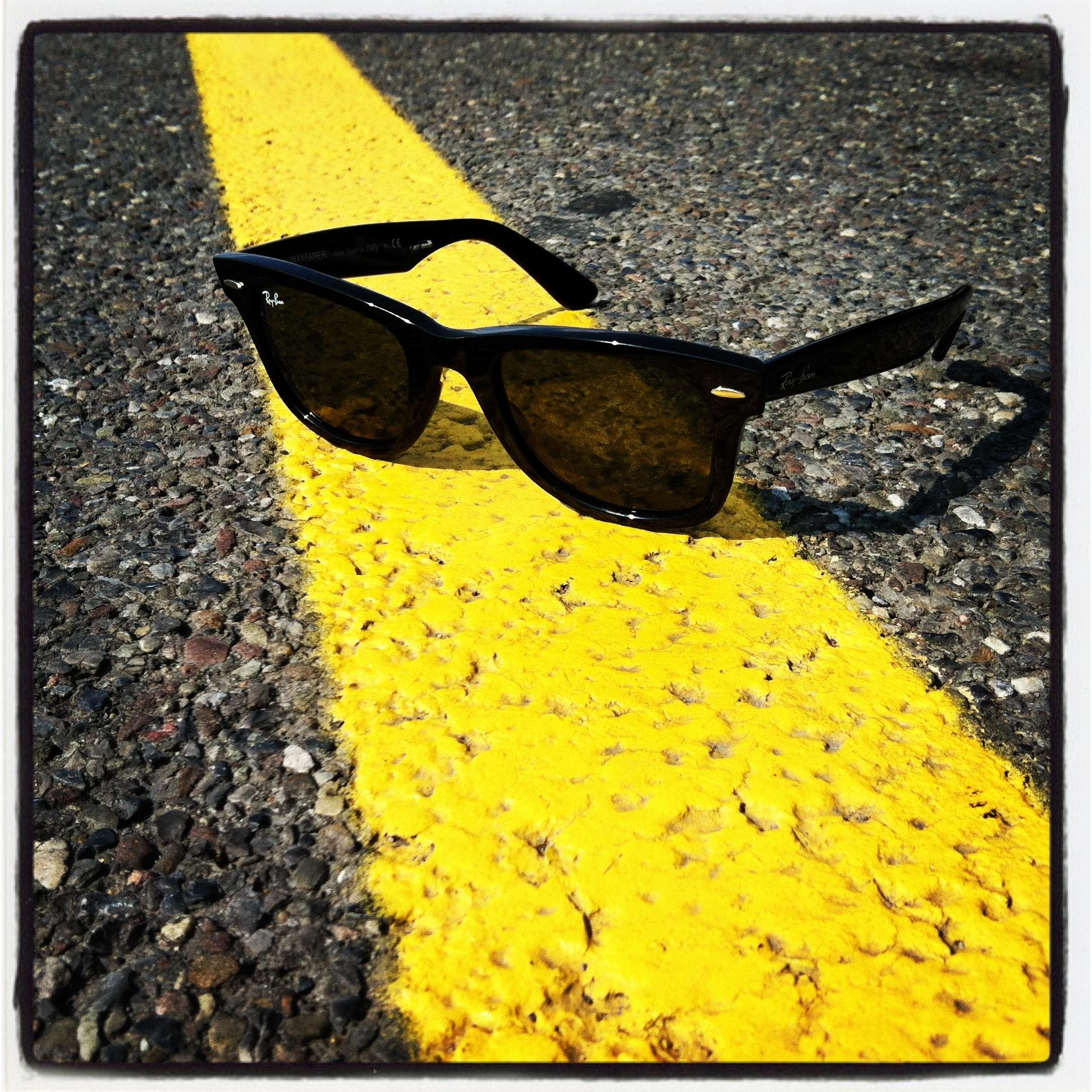 5132faa1fa Black Ray-ban Wayfarer Sunglasses over Yellow Line on Street · Free ...
