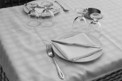 White Plate With Towel, Spoon, and Fork