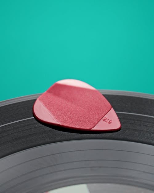 Shallow Focus Photo of Pink Guitar Pick