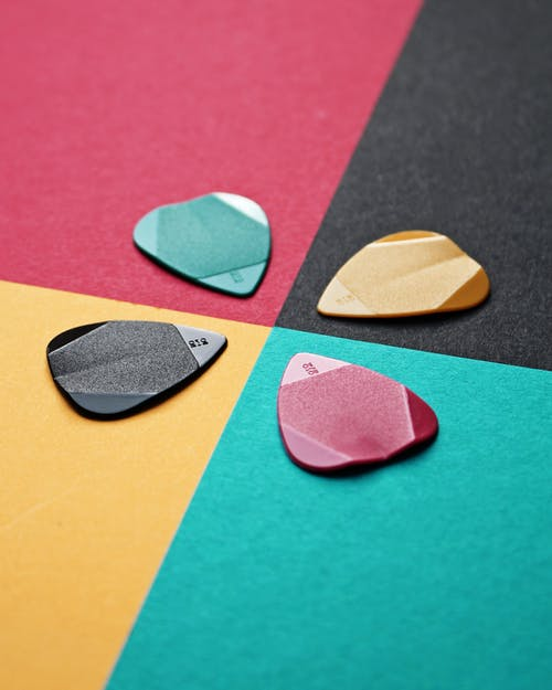 Black, Green, Yellow, and Red Guitar Pics