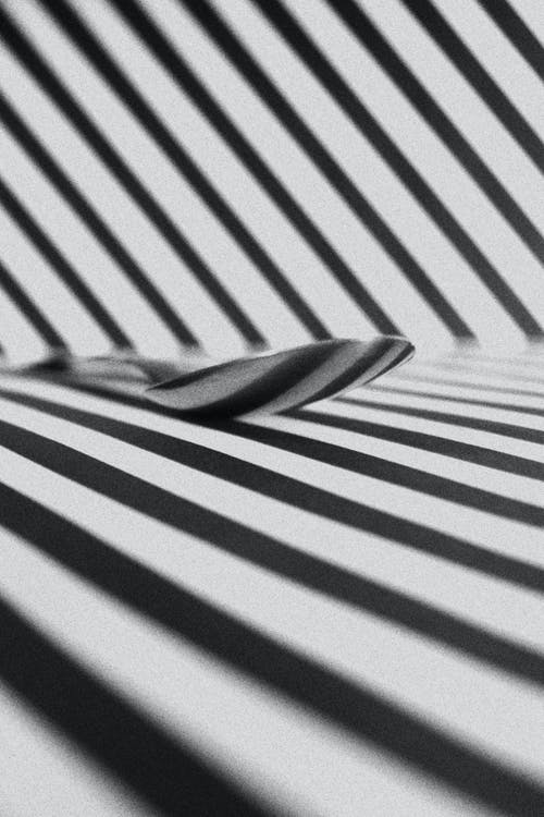 Spoon On A Surface With Black And White Stripes