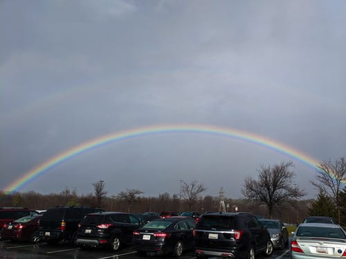 Free stock photo of cars, parking lot, rainbow