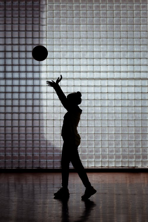 Silhouette Photography of Woman Playing Basketball