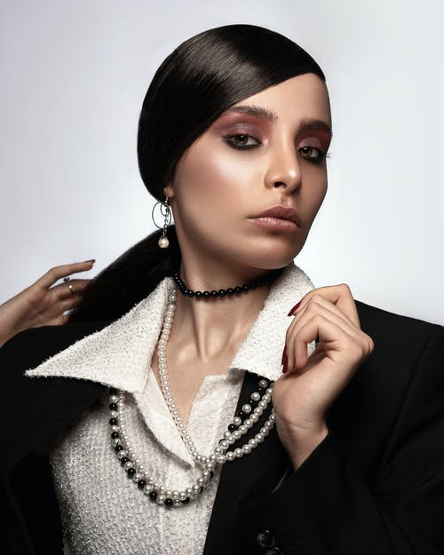 Woman Wearing Pearl Beaded Necklace