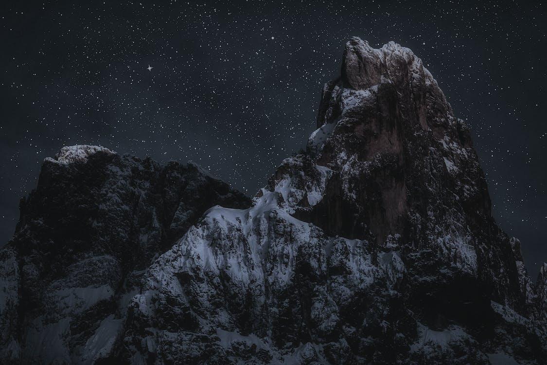 Mountain Peaks During Night Time