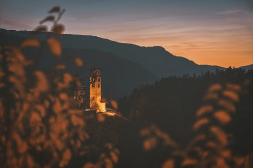 Brown Concrete Tower on Mountain during Golden Hour