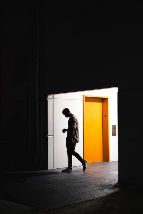 Man Entering A Dark Room