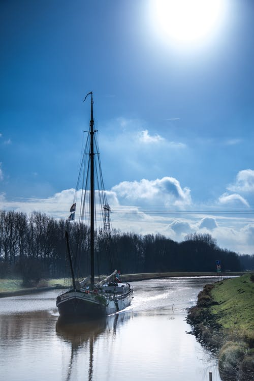 Sail Boat on River