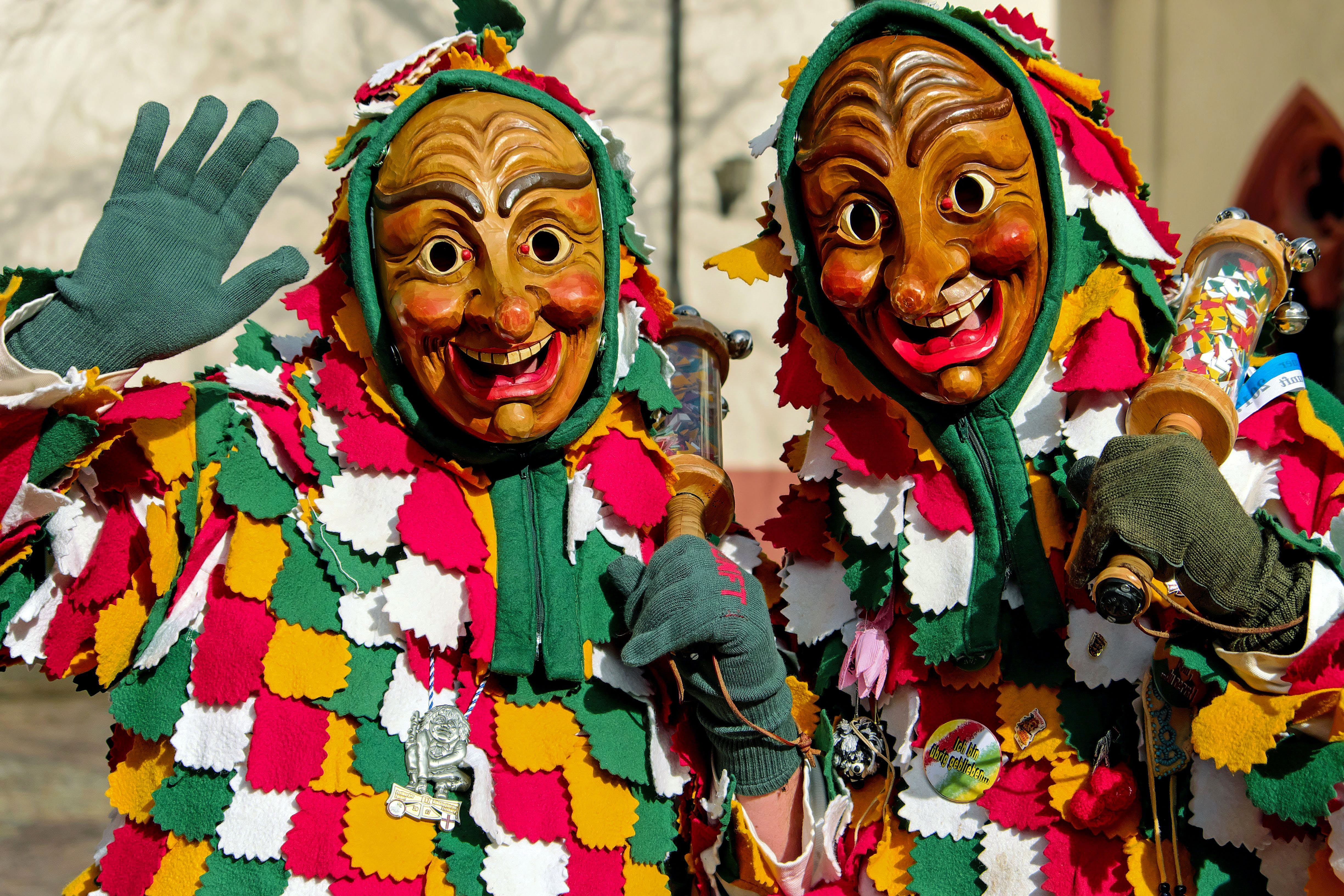 Two Person Wearing Mask Costumes