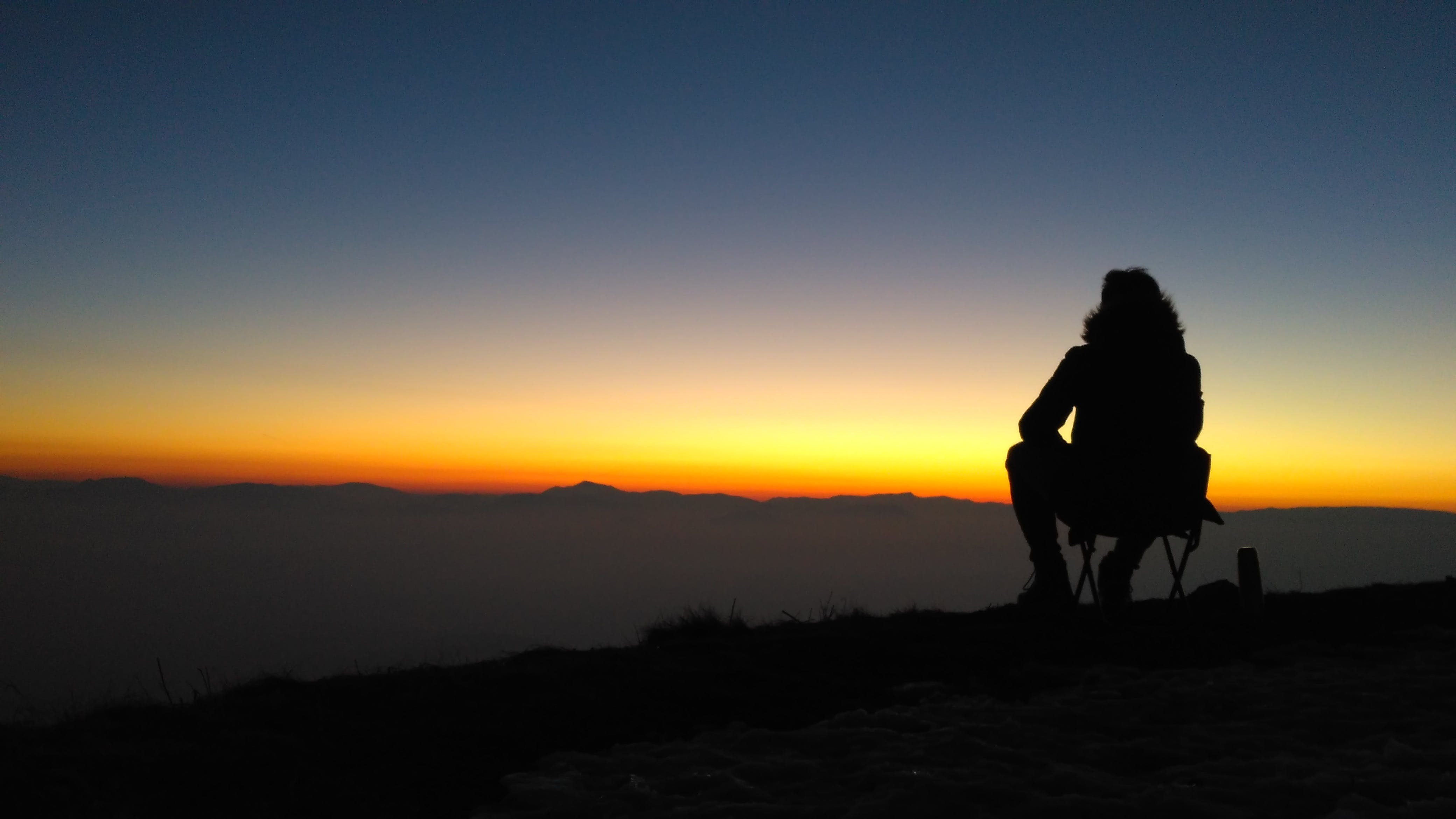 Silhouette Photography of Person Sitting on Chair