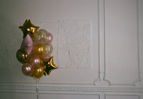 Yellow, White, and Pink Balloons